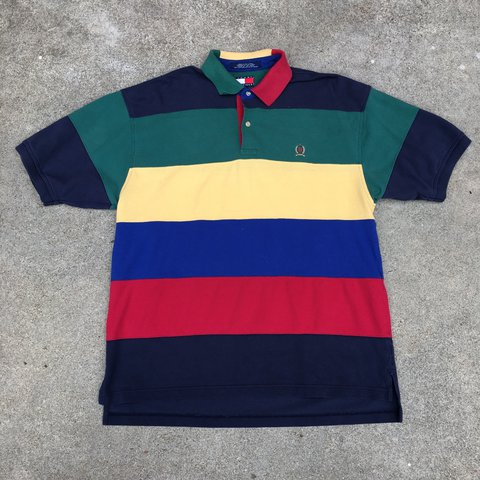 c81045977 @nightcourt. 2 years ago. Richmond, United States. Vintage 90s color block  Tommy Hilfiger polo. Good condition. Size L fits true.