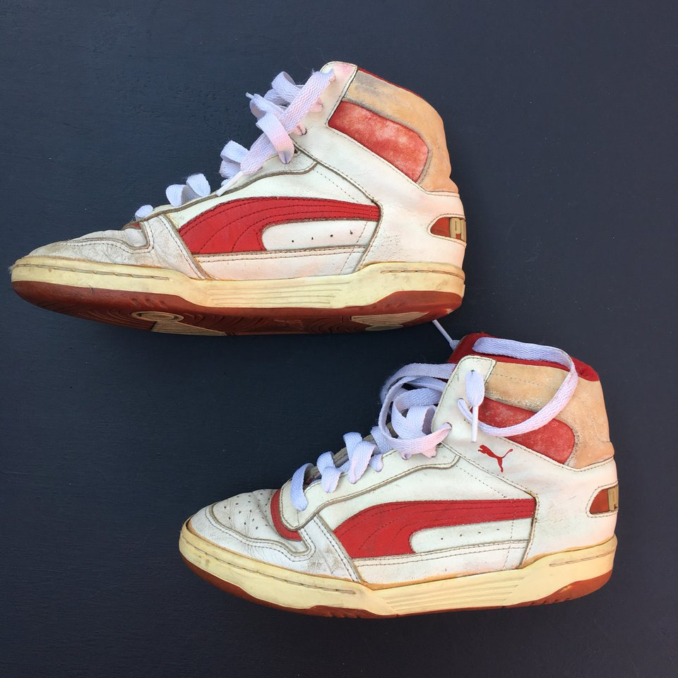 Vintage 1980s Puma high tops in heavily