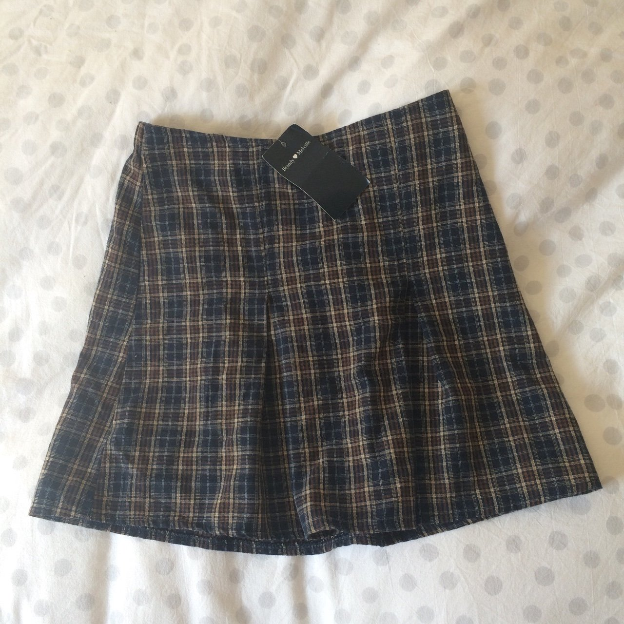 734f3532a3 Brandy Melville A-line skirt with pleats. Small gingham and - Depop
