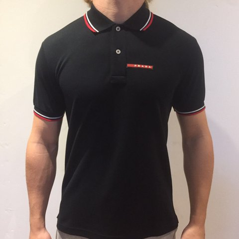 c90ffe34 @dean_walston15. 2 years ago. Sheffield, United Kingdom. Prada polo - Black  with red and white stripes 💷RRP £140 ...
