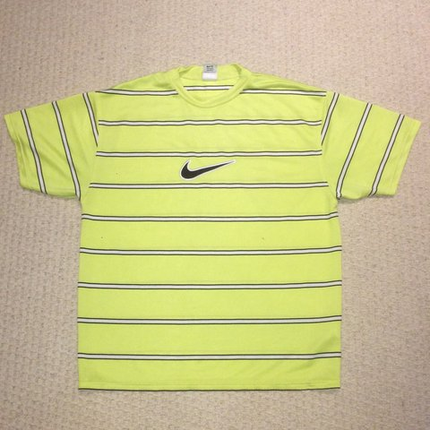 e8300c7d @vintage_garms_uk. 11 months ago. Pontypridd, United Kingdom. Men's Vintage  Nike striped embroided tick T shirt. Yellow Size l large. Great condition