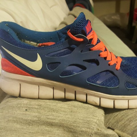 a7bfa6b2c1d9 Nike Free Run 2 in Blue Orange. Size 9 8 10 Condition Do not - Depop