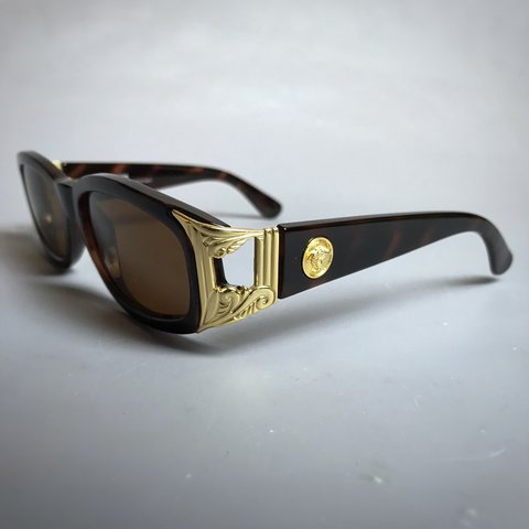 664855eb7946  emporiumsupply. last month. United Kingdom. Gianni Versace Sunglasses ...