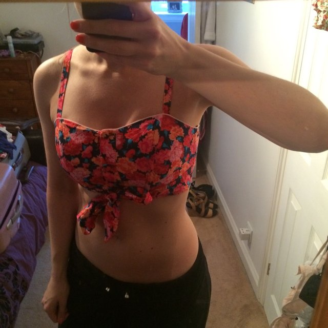 e54bf61b1ac @clareyd. 5 years ago. Romford, United Kingdom. Floral crop top with tie up  bow at front. NEVER worn UK size 8