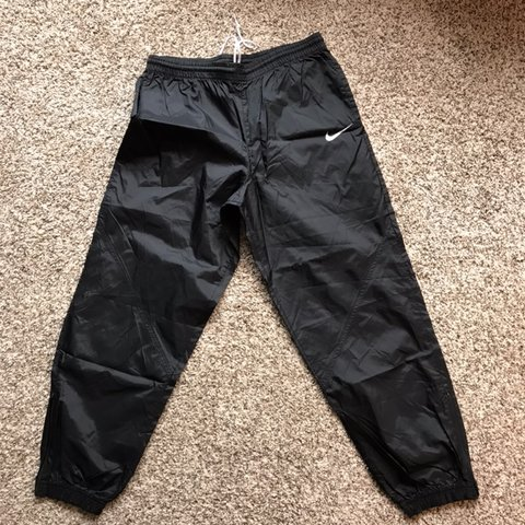 18306efc6603 Vintage Nike windbreaker pants. Elastic waist and cuffs