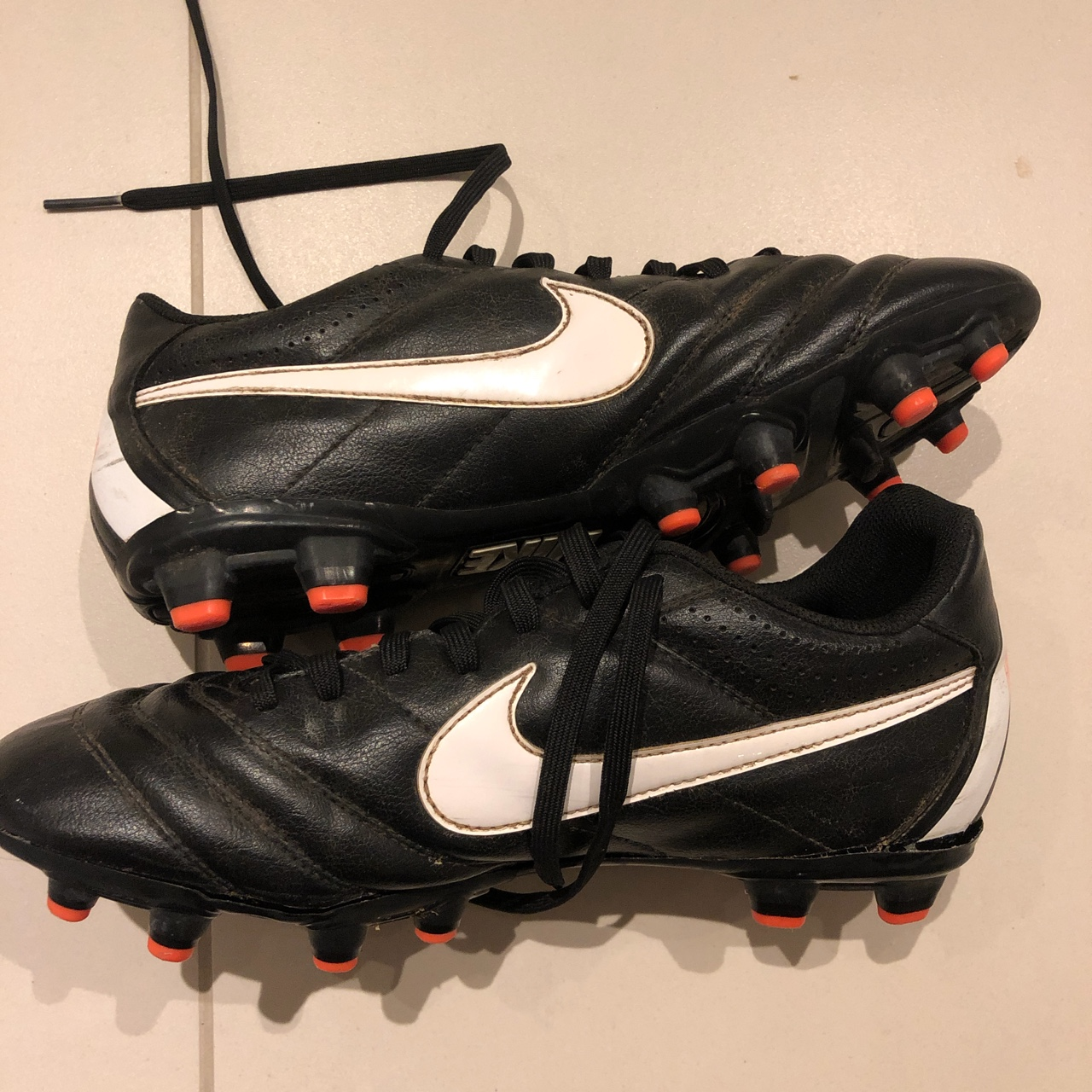 Nike black football boots with plastic