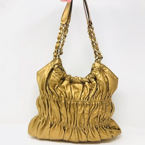 019c94a6eb2a @itshadrian. last year. Chino Hills, United States. Gorgeous metallic gold Michael  Kors ruched Shoulder Bag.