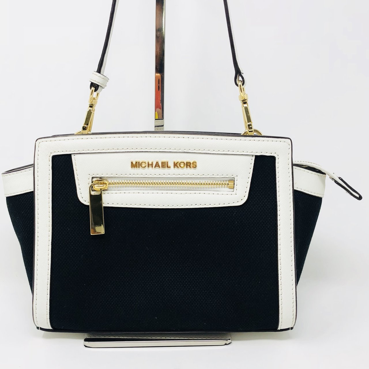 52cc78d8feb7 @itshadrian. 9 months ago. Chino Hills, United States. Gorgeous black  canvas and white saffiano leather Michael Kors small Selma Crossbody Bag  with gold ...