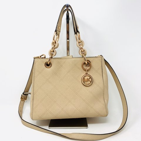 c5fed39a2d72 @itshadrian. 4 months ago. Chino Hills, United States. Gorgeous nude/blush  colored saffiano leather quilted Michael Kors satchel ...