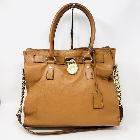 a25562ace054 @itshadrian. 3 months ago. Chino Hills, United States. Beautiful golden  brown pebbled leather Michael by Michael Kors Hamilton satchel ...