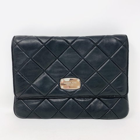 76c026c14988 @itshadrian. 2 months ago. Chino Hills, United States. Gorgeous black  quilted lamb skin Michael by Michael Kors envelope with silver hardware.