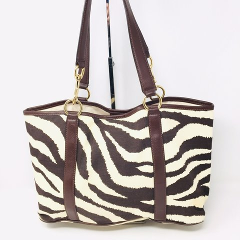 27ea29f23126 @itshadrian. last month. Anaheim, United States. Check out this super cute zebra  print Michael Kors tote ...