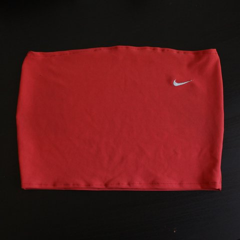 fc177c2a841de Coral   reddish Nike bandeau top. Silver embroidered logo