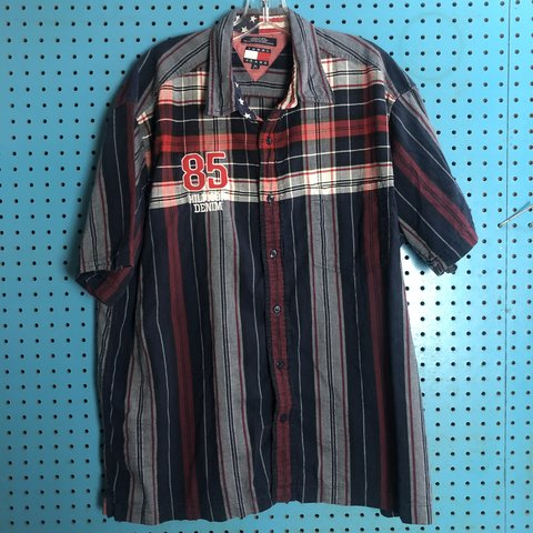 49da9fa8 @downtownvintageco. 4 months ago. United, United States. Y2K 2000s Tommy  Hilfiger Blue Plaid Button Front shirt with embroidery detail and big flag  ...