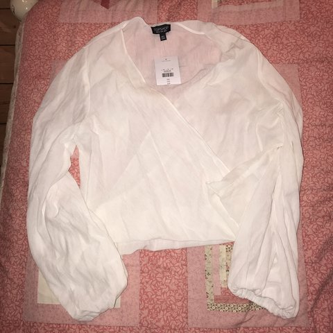 11c9db6a976 @ecowper. 3 months ago. United Kingdom. Topshop white wrap blouse. Still  with tags never been worn