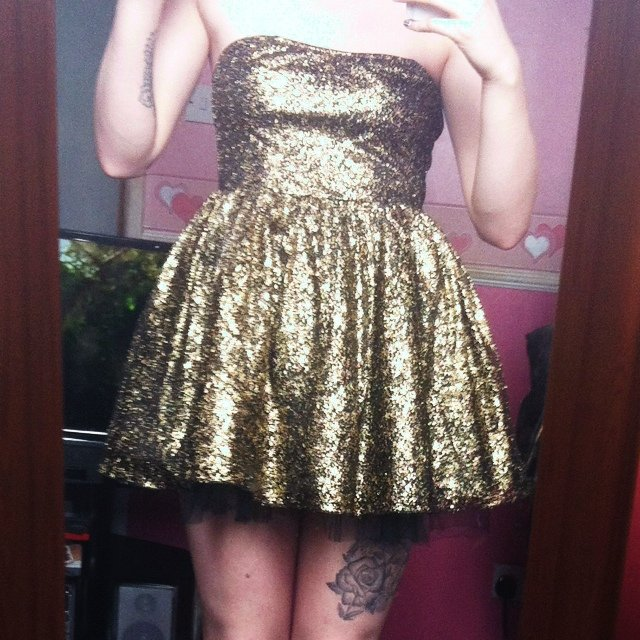 c1204295 @emneylon. 5 years ago. Hull, United Kingdom. Gold/black sparkly puff dress.  Topshop. Never worn, still with tags. Size ...