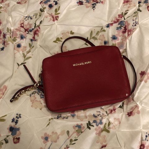 75109d22e4c3 Red Michael Kors crossbody purse. Small white paint stain on - Depop