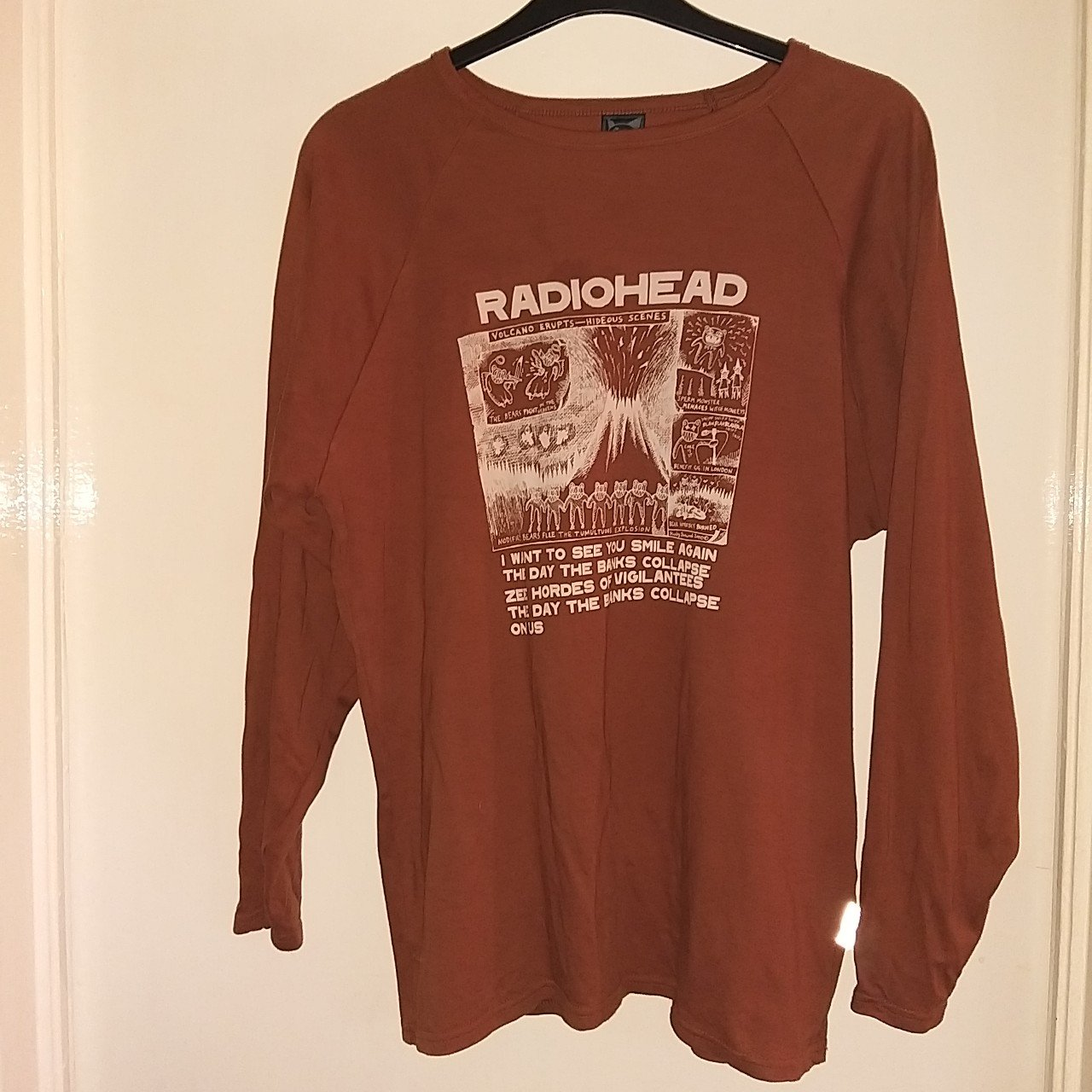 1adf6d361005 @comeasyouare1. 21 days ago. Liverpool, GB. Brown long sleeved radiohead t  shirt.