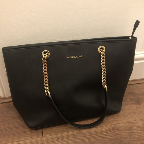 32c7e963a861 @ariannamott. 3 months ago. London, United Kingdom. Large black and gold Michael  kors chain bag. Really good condition, hardly used.