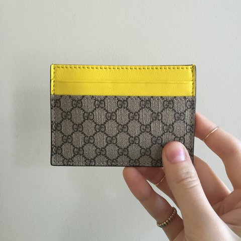 057effc5dcff @clairegeist. 3 years ago. United States. Genu-iine yellow leather Gucci  card holder / wallet. Yes ...