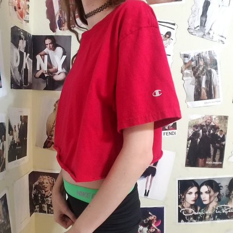 0f67c7cdaaf Bright red Champion crop top. Logo on the sleeve. Fits like - Depop