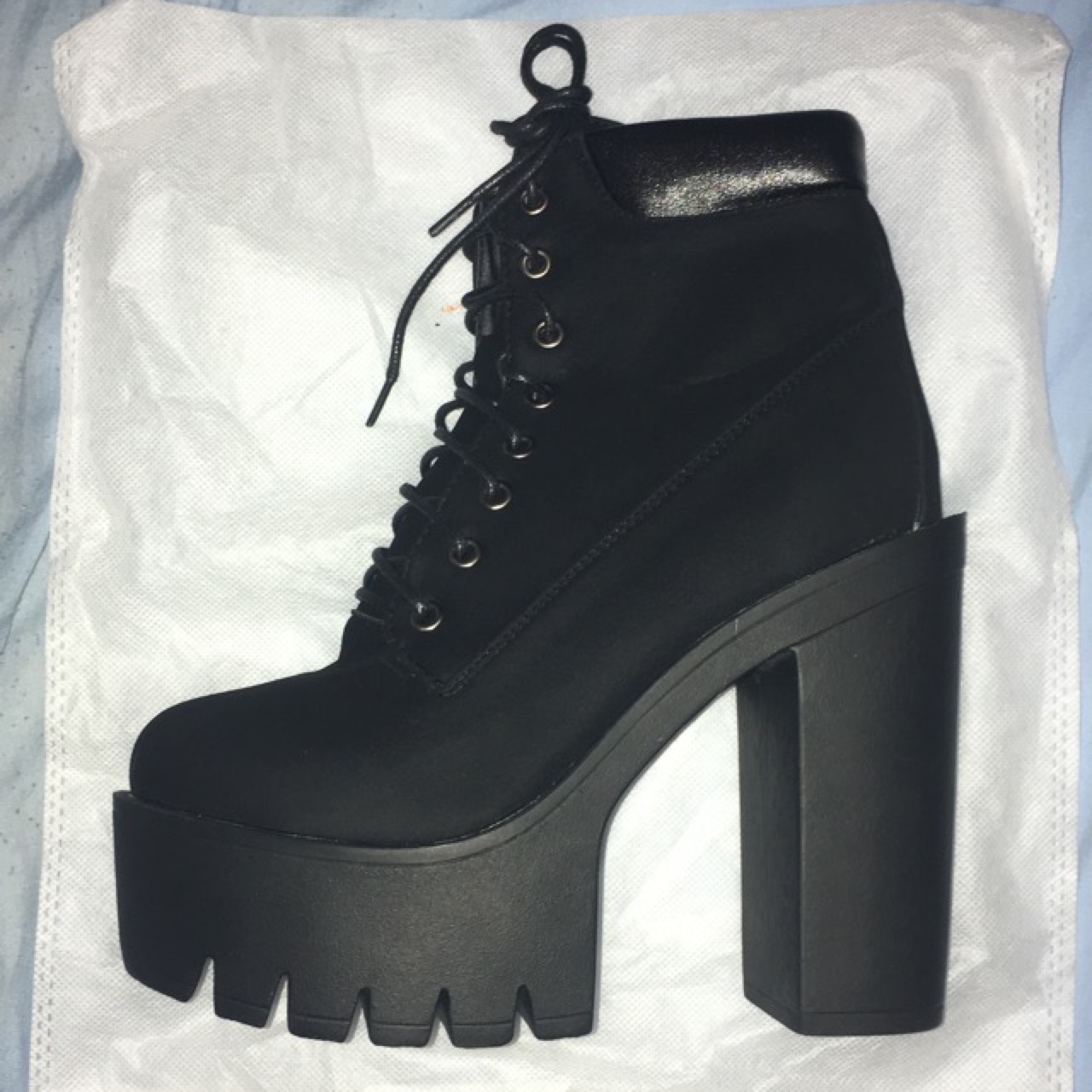 Black timberland style heeled boots, never got to Depop