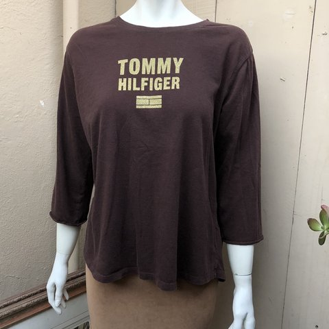 356f262d0 @arivnv. yesterday. Stanton, United States. Tommy Hilfiger brown 3/4 sleeve  top. Labeled a women's XL