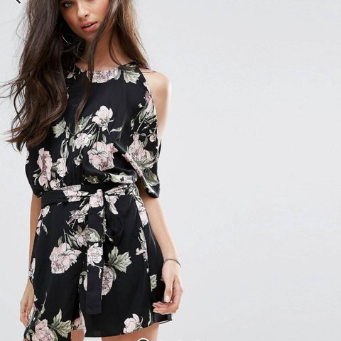 bd0743ab596a River island petite floral playsuit in size 8. Brand new and - Depop
