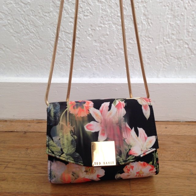 851f8a312b @elizabethminett. 5 years ago. Los Angeles, CA, USA. Brand new Ted Baker  purse. Silk floral fabric.