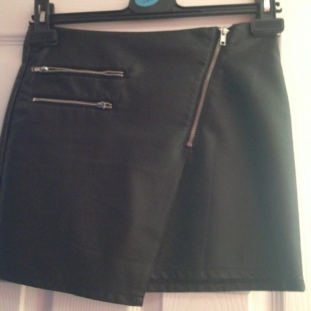 H&M black faux leather asymmetrical skirt with silver zips, worn ...