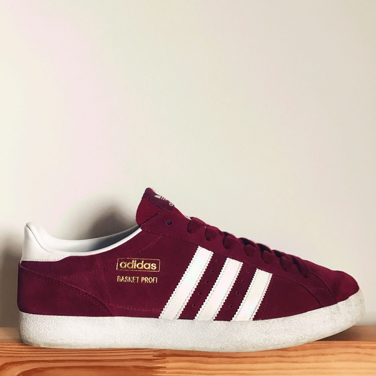 100% authentique 62dae eee66 Adidas Basket Profi. Burgundy with white stripes and... - Depop