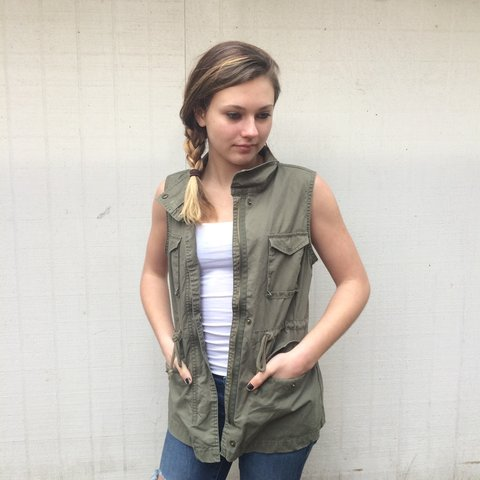 40f414af793a0 Army green sleeveless jacket. Love love the look but I m not - Depop