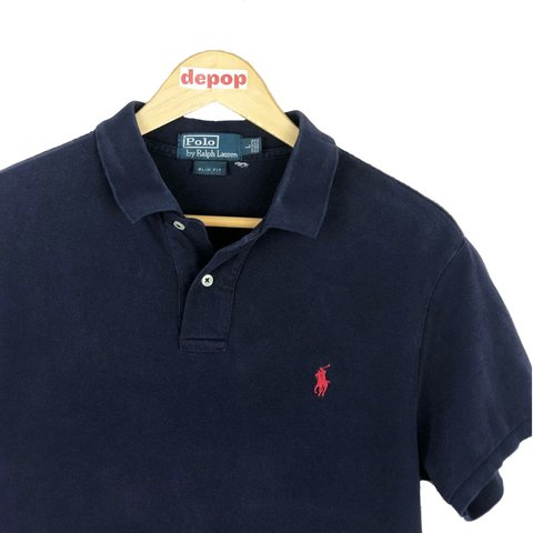 a448129fe46 @freshvintagegb. 10 months ago. Glossop, United Kingdom. Vintage Ralph  Lauren polo shirt. Navy blue and red embroidered logo