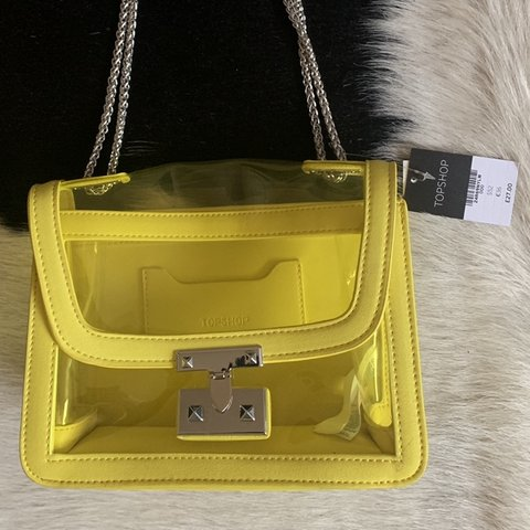f13bef60e @p0ppyrobinson. 3 months ago. London, United Kingdom. TOPSHOP yellow  transparent crossbody or shoulder bag