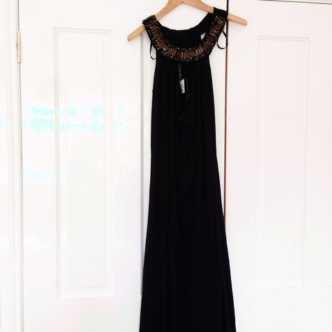 b77115a87b61d Long black maxi dress, with gold chain detail around the has - Depop
