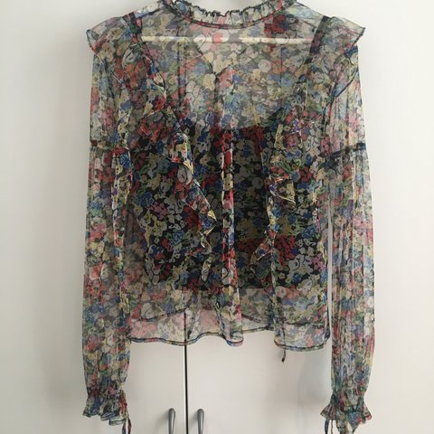 c4153524517ec Floral sheer blouse from Topshop with ruffle details
