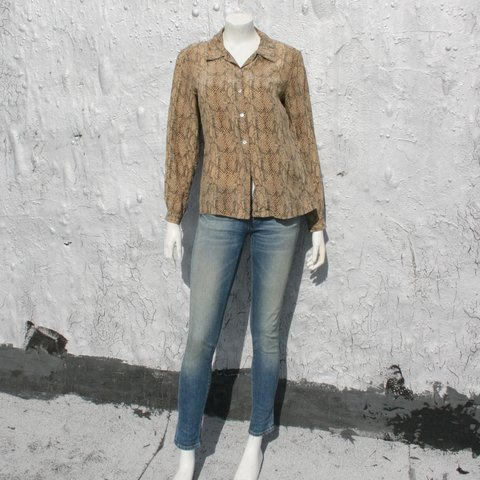 8bc87a034fa9d  raggedglory. 2 years ago. United States. August Silk vintage snakeskin  print button down blouse. Oversized fit.