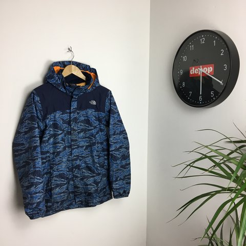 d7bf52d21b883 @huntsemporia. 2 years ago. Derby, United Kingdom. The North Face Blue Camo  Patterned Waterproof Jacket - Size ...