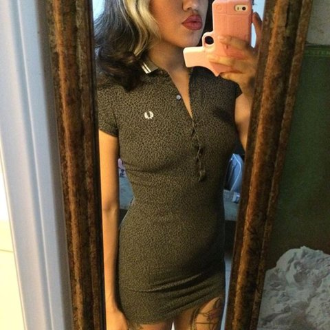 3bc0c2b93568 @midcenturymuse. 2 years ago. South Pasadena, United States. RARE Fred  Perry Amy Winehouse Polo Dress. Grey with black ...