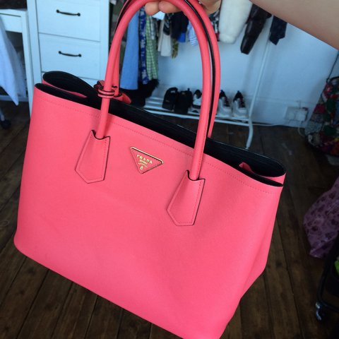 62e000b4ff37 @belladray. 3 months ago. London, United Kingdom. Prada hot pink / neon  pink bag has smaller compartment ...
