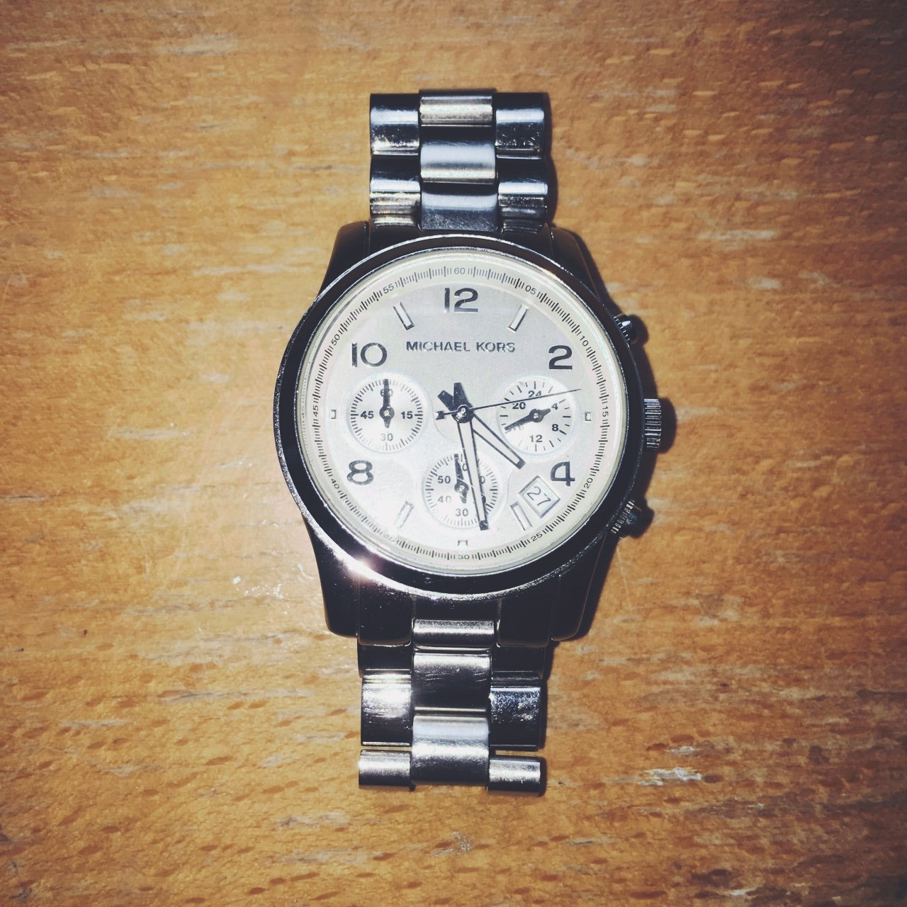ef0ace14f9e8 Michael Kors silver watch. Three faces