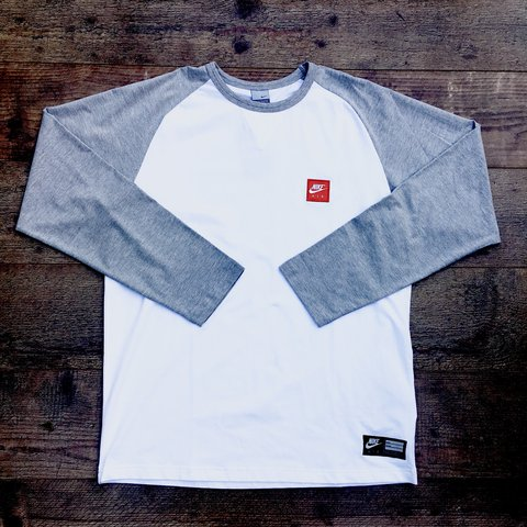 ce20f7b3ca1 @systemf. 9 months ago. Nottingham, United Kingdom. Brand new white and  grey Nike Air long sleeved tee shirt ...