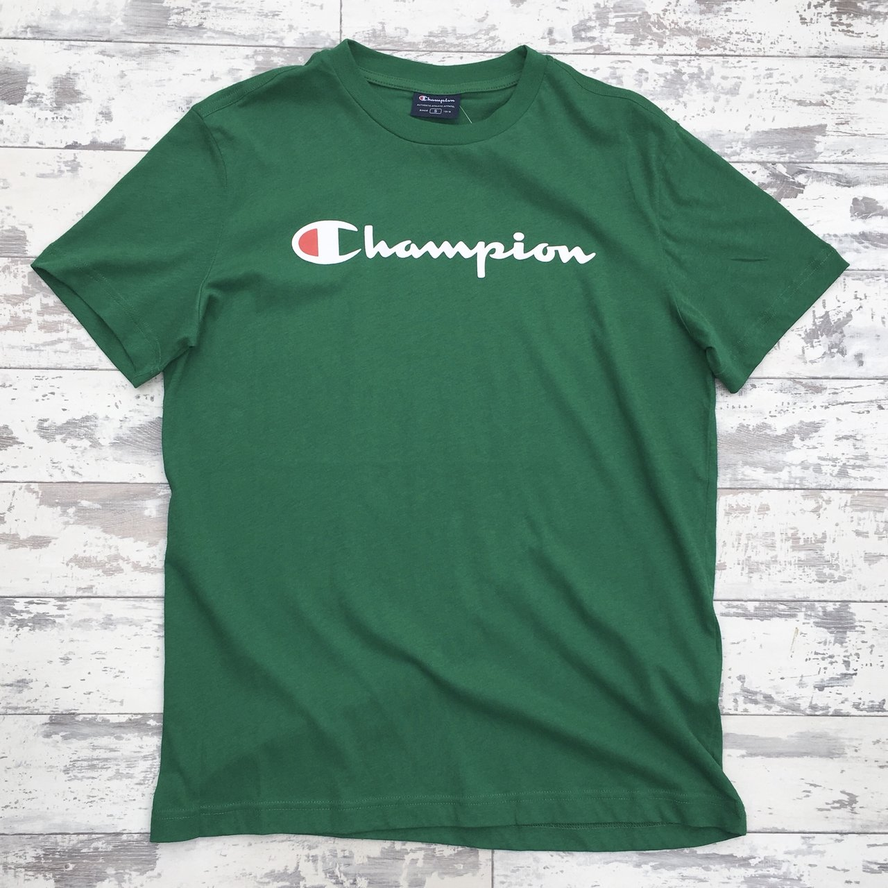 756440ec @systemf. last year. Nottingham, United Kingdom. Brand new green Champion  tee shirt