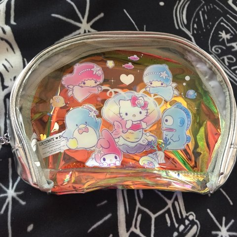 dea28ede6 Holographic Hello Kitty mermaid pouch. Great for travel or a - Depop