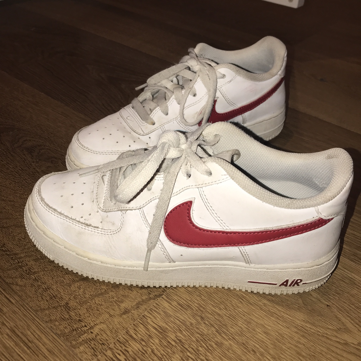 White and red tick Nike Air Force