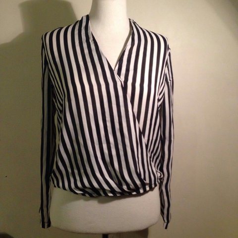 f91e8c83b73 @maiko_dizon. 3 years ago. Bristol, United Kingdom. MISSGUIDED. Wrap over  black and white long-sleeve top, stripes. Never been worn, without tags.