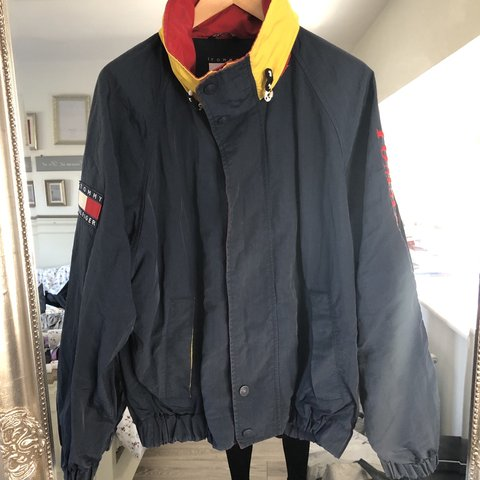 36b81061 @lmcellin. 8 days ago. Bristol, United Kingdom. Vintage rare navy blue, red  , yellow Tommy Hilfiger jacket / coat with hood, size ...