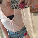 frilly lil pink top, pictured on a 10?? Depop