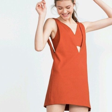83160337 @sarah_fearnall. 10 months ago. Chester, United Kingdom. Zara burnt orange  dress with under barlet, new with tags