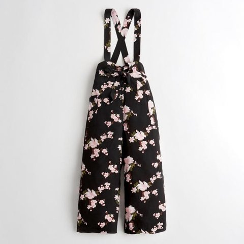 0cba42872b7 WANTED* Hollister Belted Culotte Overalls in Black Floral. - Depop